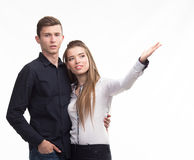 Young couple pointing by hand Royalty Free Stock Images