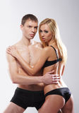 A young and sexy couple posing in black lingerie Royalty Free Stock Photos