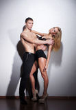 A young and sexy couple posing in black lingerie Royalty Free Stock Photo