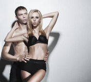 A young and sexy couple posing in black lingerie Royalty Free Stock Image