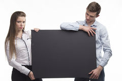 Young sexy couple showing presentation pointing on placard Royalty Free Stock Photo