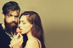 Sexy couple eating red strawberry