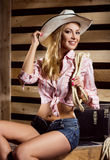Young and sexy cowgirl posing in a barn Stock Images