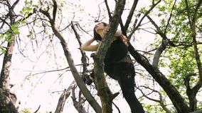 Young dancer woman dancing on the tree. stock video footage