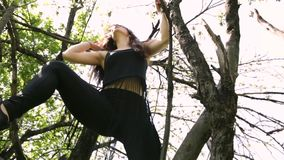Young dancer woman dancing on the tree. stock video