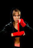 Young sexy dangerous boxing girl wrapping hands and wrists female combat boxer. Young sexy angry and dangerous looking boxing girl wrapping hands and wrists Royalty Free Stock Photo
