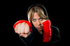 Young sexy dangerous girl shadow boxing with wrapped hands and wrists training workout. Young sexy angry and dangerous looking girl shadow boxing with wrapped Royalty Free Stock Photo