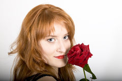 Young elegant woman with red rose Stock Images