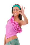 Young sexy fashion model with ok gesture Royalty Free Stock Image