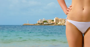Young sexy female body on sea background. Stock Images