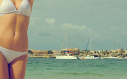 Young female body on sea background. Royalty Free Stock Photos