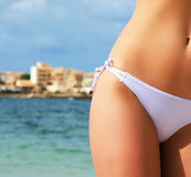 Young sexy female body on sea background. Stock Image