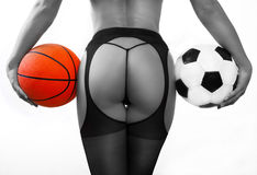 Young sexy girl with balls, basketball and soccer Stock Image