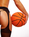 Young sexy girl with basket ball Royalty Free Stock Images