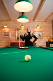 Young sexy girl with billiard balls Royalty Free Stock Photo