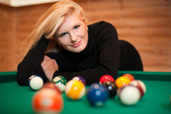 Young sexy girl with billiard balls Stock Image