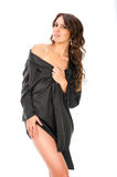 Young sexy girl in a black bathrobe posing in studio Royalty Free Stock Photography