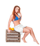 Young sexy girl in blue bikini with orange Royalty Free Stock Photos