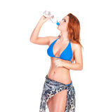 Young sexy girl in blue bikini and shawl drinking water Stock Photo