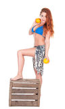 Young sexy girl in blue bikini and shawl holding orange Stock Photo