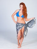Young sexy girl in blue bikini and shawl posing Royalty Free Stock Photos