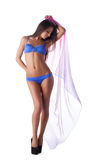 Young sexy girl in blue bikini swimsuit with cape Royalty Free Stock Photos