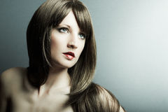 The young sexy girl in chestnut-coloured wig Royalty Free Stock Image