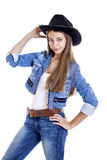 Young sexy girl in a cowboy hat. Isolated on white background Royalty Free Stock Photo