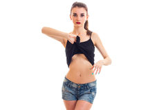 Young sexy girl in denim shorts raises the hand t-shirt Royalty Free Stock Image