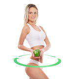 Young sexy girl with exotic fruit isolated on white. Sporty, fit and sporty woman with the arrows cycle and the pepper in her hands (healthy eating, vitamins and Stock Photo