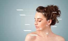Young sexy girl with facial treatment modern arrows Royalty Free Stock Images