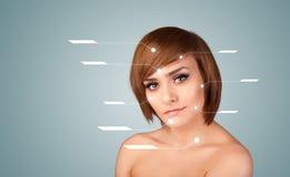 Young sexy girl with facial treatment modern arrows Royalty Free Stock Photos