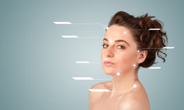 Young sexy girl with facial treatment modern arrows Royalty Free Stock Image