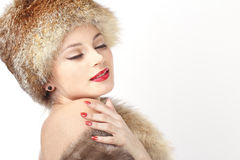 Sexy girl in hat. Young sexy girl in fur hat is close your eyes Stock Photography