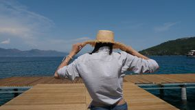 Young sexy girl in a hat and shorts walking on the pier. In Turkey stock footage