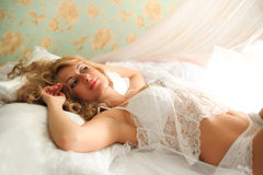 Young sexy girl in lingerie on bed Royalty Free Stock Images