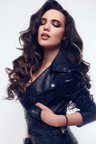 Young sexy girl with long hair in leather jacket Stock Photos