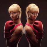 Young girl over black background with boxing gloves royalty free stock photo
