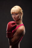 Young sexy girl over black background with boxing gloves Stock Photo