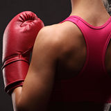 Young sexy girl over black background with boxing gloves Stock Photography