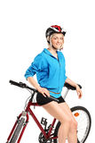A young girl posing on a bike Royalty Free Stock Images