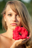 Young sexy girl with red flower #2 Royalty Free Stock Photos