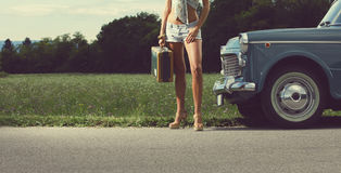 Young sexy girl on the road Royalty Free Stock Image