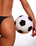 Young sexy girl with soccer ball Stock Images