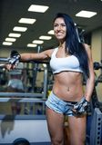 Young sexy girl in a sports gym Royalty Free Stock Image