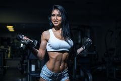 Young sexy girl in a sports gym Stock Photo