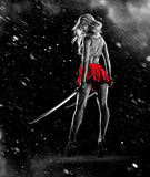 Young girl is standing with the swords Royalty Free Stock Image