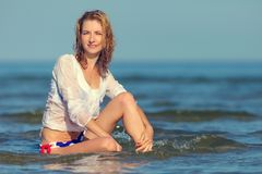 Sexy girl in a swimsuit at the sea. Young sexy girl in a swimsuit at the sea royalty free stock images