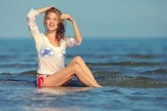 Sexy girl in a swimsuit at the sea. Young sexy girl in a swimsuit at the sea stock image