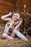 Young sexy girl in underwear  sit in the barn with hay Stock Photos